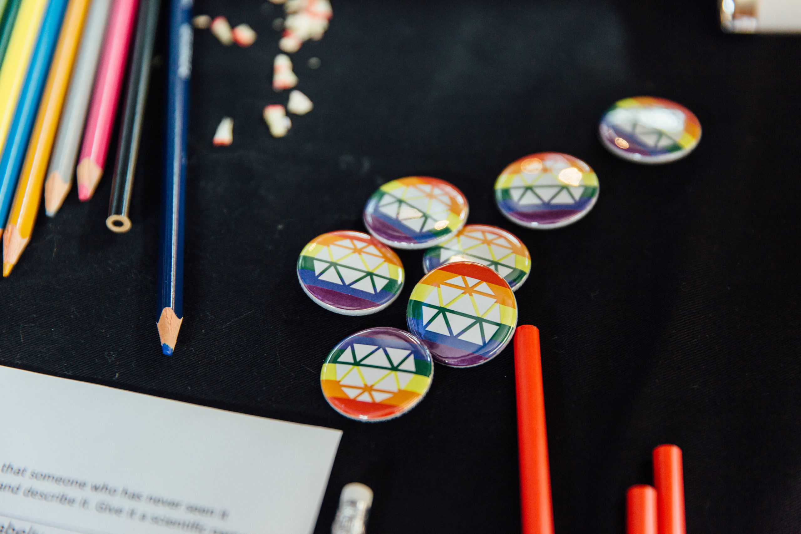 LGBTQ+ STEM Science World rainbow buttons for pride day.